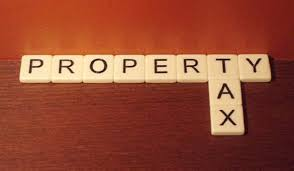 Why does the UK pay the highest rate of property tax in the world?